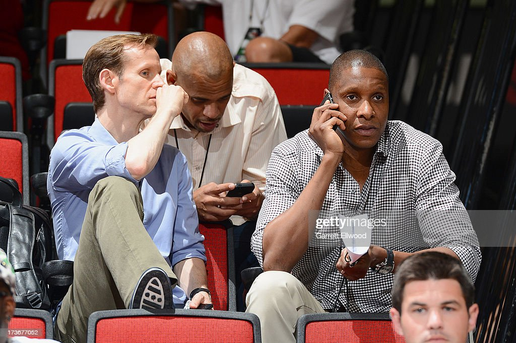 Jeff Weltman (L) and Masai Ujiri watch the NBA Summer League game between the Chicago Bullsand the Portland Trail Blazers on July 16, 2013 at the Cox Pavilion in Las Vegas, Nevada.
