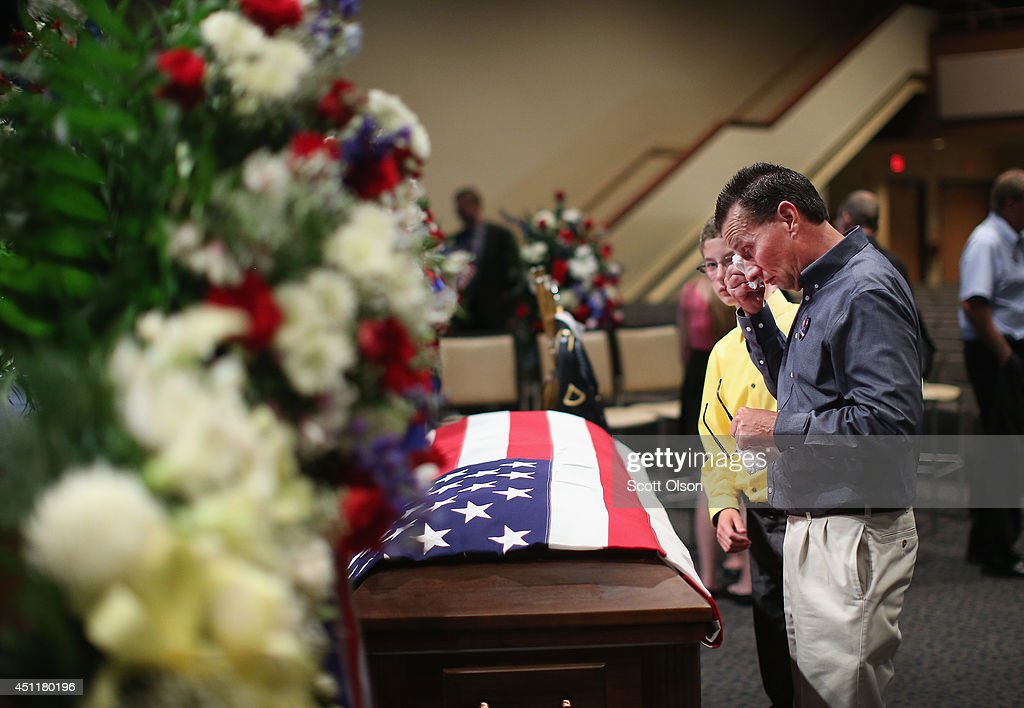 Jeff Winter wipes a tear as he pays his respects to his nephew, U.S. Army Pfc. Aaron Toppen, during a visitation at Parkview Christian Church on June 23, 2014 in Mokena, Illinois. Toppen, 19, was killed alongside four other American soldiers and an Afghan soldier in a friendly fire airstrike while they were engaged in a firefight earlier this month in Afghanistan.
