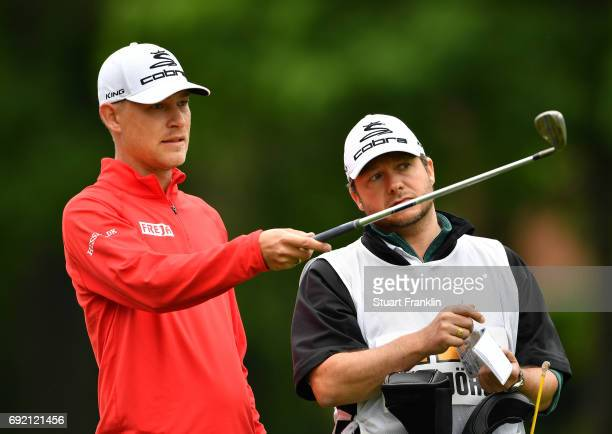 Jeff Winther of Denmark and caddie discuss a shot during the final round of The Nordea Masters at Barseback Golf Country Club on June 4 2017 in...