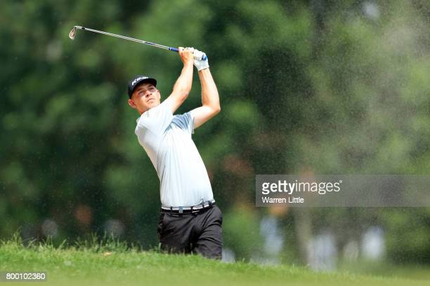 Jeff Winther of Denmark hits his second shot on the 10th hole during day two of the BMW International Open at Golfclub Munchen Eichenried on June 23...