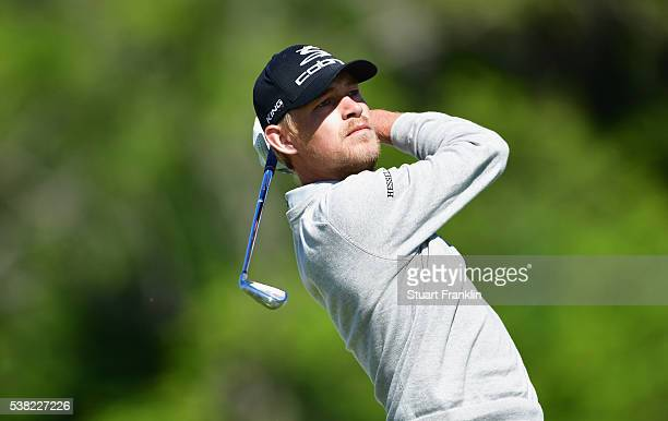Jeff Winther of Denmark plays a shot on the 4th hole during the final round on day four of the Nordea Masters at Bro Hof Slott Golf Club on June 5...
