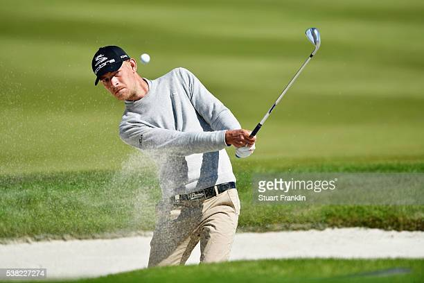 Jeff Winther of Denmark plays out of a bunker on the 3rd hole during the final round on day four of the Nordea Masters at Bro Hof Slott Golf Club on...