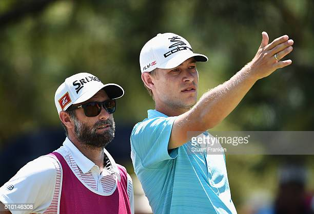 Jeff Winther of Denmark talks with his caddie on the 10th hole during the final round of the Tshwane Open at Pretoria Country Club on February 14...