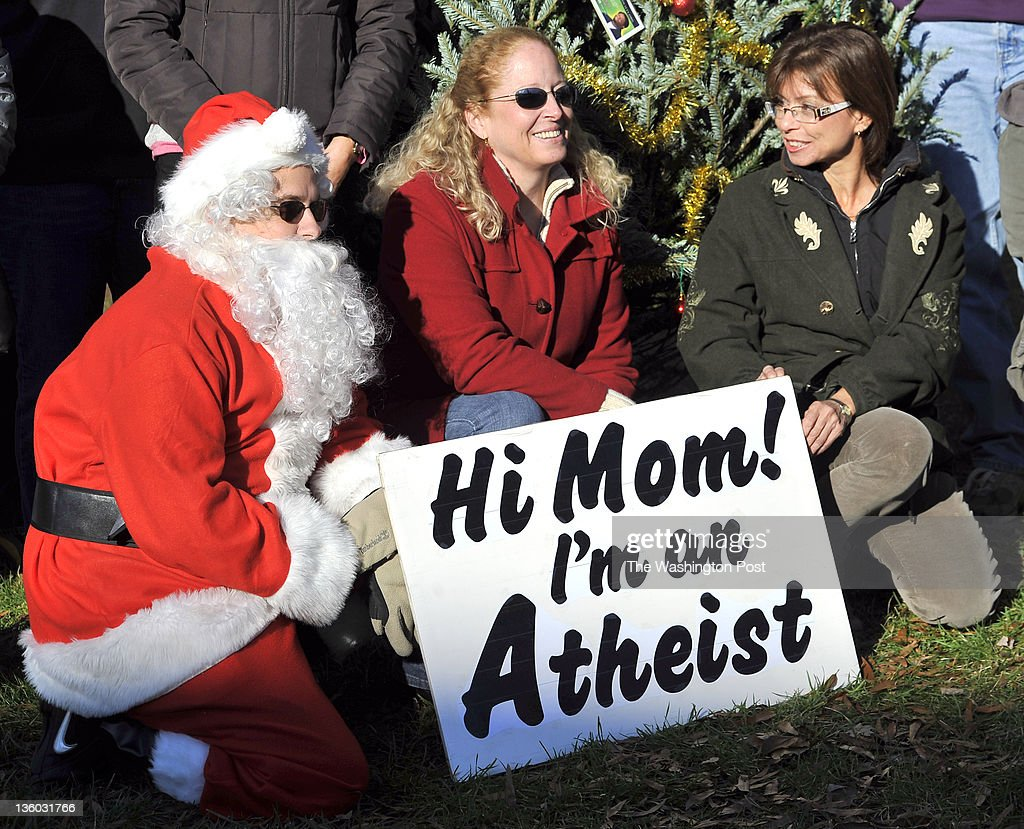 Jeff Wismer Ellen Birch and Stephanie Ragusky posed with others in front of the atheist tree on the lawn of the Loudoun County Courthouse on December...