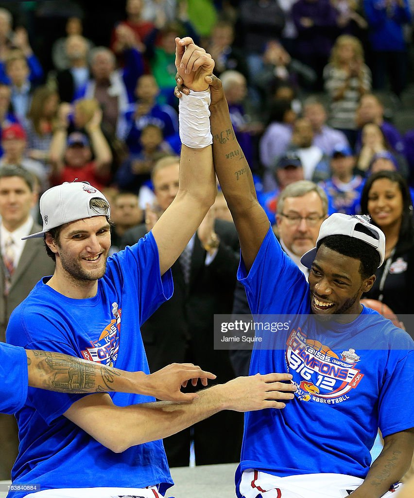 Jeff Withey #5 and Elijah Johnson #15 of the Kansas Jayhawks celebrate their 70-54 win over Kansas State Wildcats during the Final of the Big 12 basketball tournament at Sprint Center on March 16, 2013 in Kansas City, Missouri.