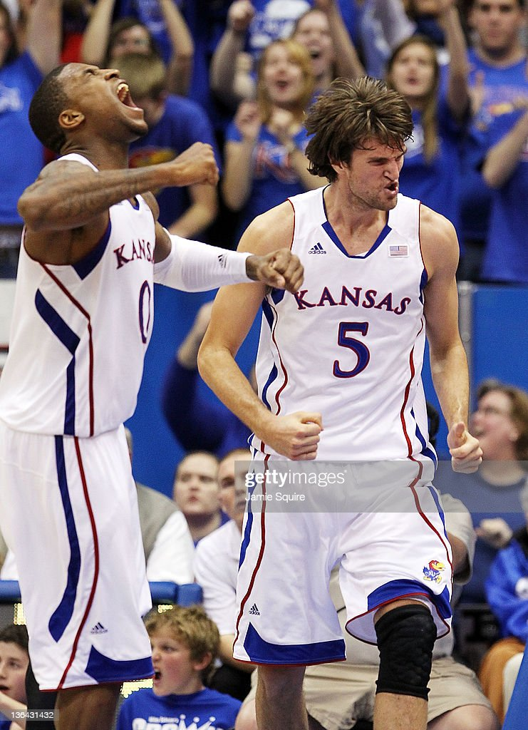 Jeff Withey and Thomas Robinson of the Kansas Jayhawks celebrate after scoring during the game against the Kansas State Wildcats on January 4 2012 at...