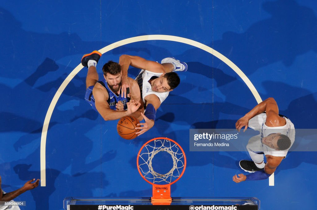 Jeff Withey #17 of the Dallas Mavericks goes to the basket against Nikola Vucevic #9 of the Orlando Magic during a preseason game on October 5, 2017 at Amway Center in Orlando, Florida.