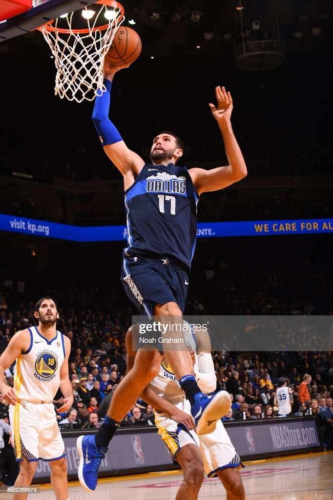 Jeff Withey #17 of the Dallas Mavericks goes to the basket against the Golden State Warriors on December 14, 2017 at ORACLE Arena in Oakland, California.