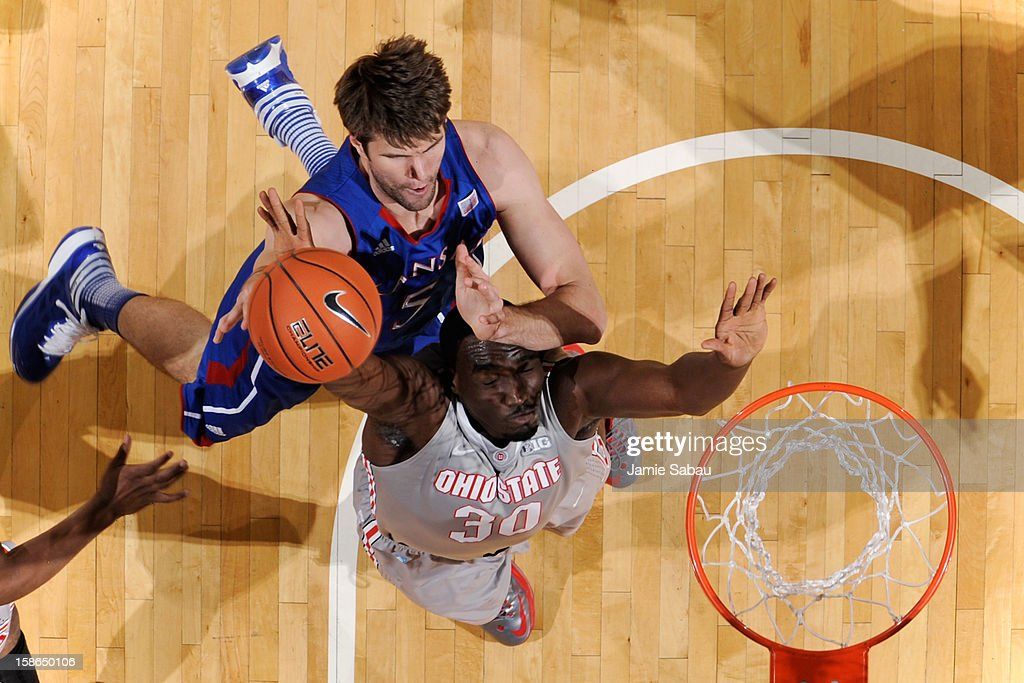 <a gi-track='captionPersonalityLinkClicked' href=/galleries/search?phrase=Jeff+Withey&family=editorial&specificpeople=6669172 ng-click='$event.stopPropagation()'>Jeff Withey</a> #5 of the Kansas Jayhawks and Evan Ravenel #30 of the Ohio State Buckeyes battle for a rebound in the first half on December 22, 2012 at Value City Arena in Columbus, Ohio. Kansas defeated Ohio State 74-66.