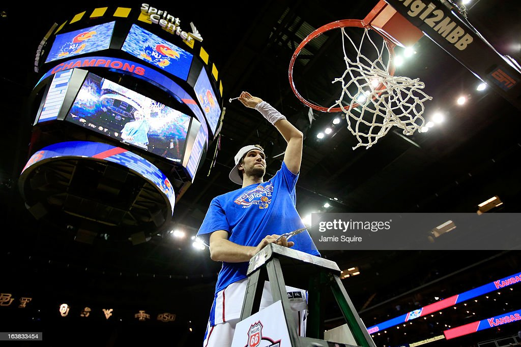 Jeff Withey #5 of the Kansas Jayhawks cuts the net in celebration of their 70-54 victory over the Kansas State Wildcats during the Final of the Big 12 basketball tournament at Sprint Center on March 16, 2013 in Kansas City, Missouri.
