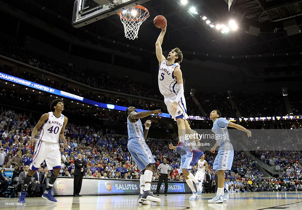 <a gi-track='captionPersonalityLinkClicked' href=/galleries/search?phrase=Jeff+Withey&family=editorial&specificpeople=6669172 ng-click='$event.stopPropagation()'>Jeff Withey</a> #5 of the Kansas Jayhawks dunks in the first half against the North Carolina Tar Heels during the third round of the 2013 NCAA Men's Basketball Tournament at Sprint Center on March 24, 2013 in Kansas City, Missouri.