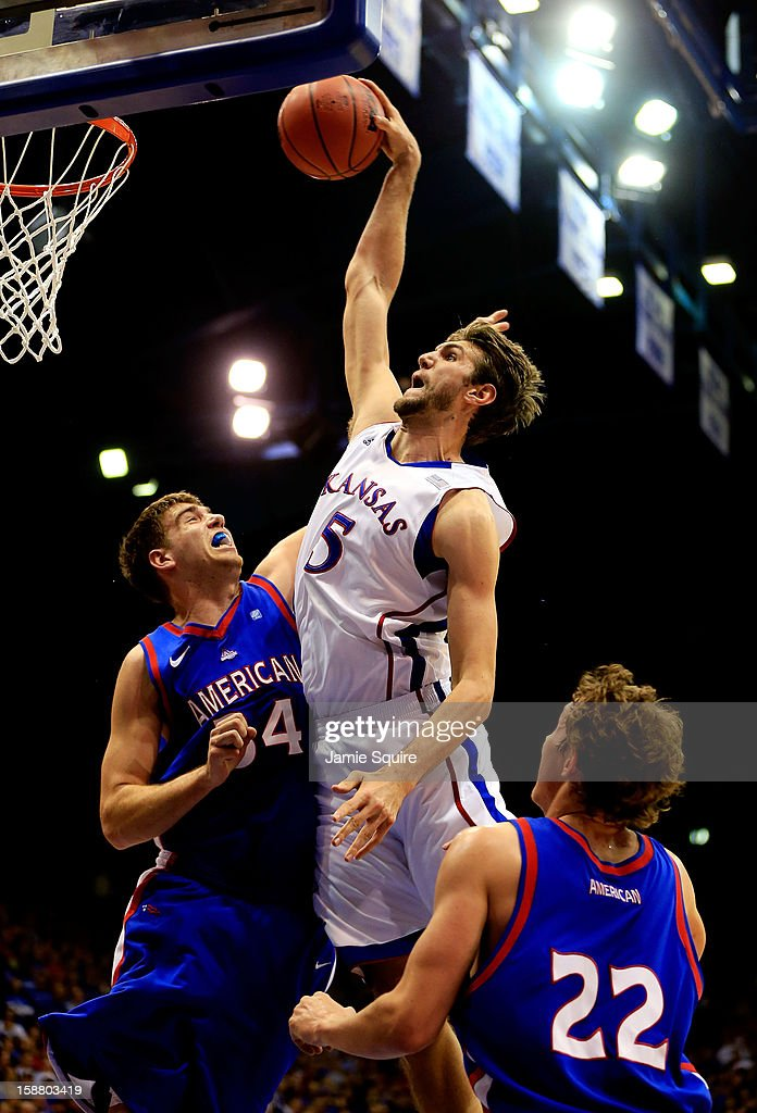 Jeff Withey of the Kansas Jayhawks dunks over Tony Wroblicky of the American University Eagles during the game at Allen Fieldhouse on December 29...