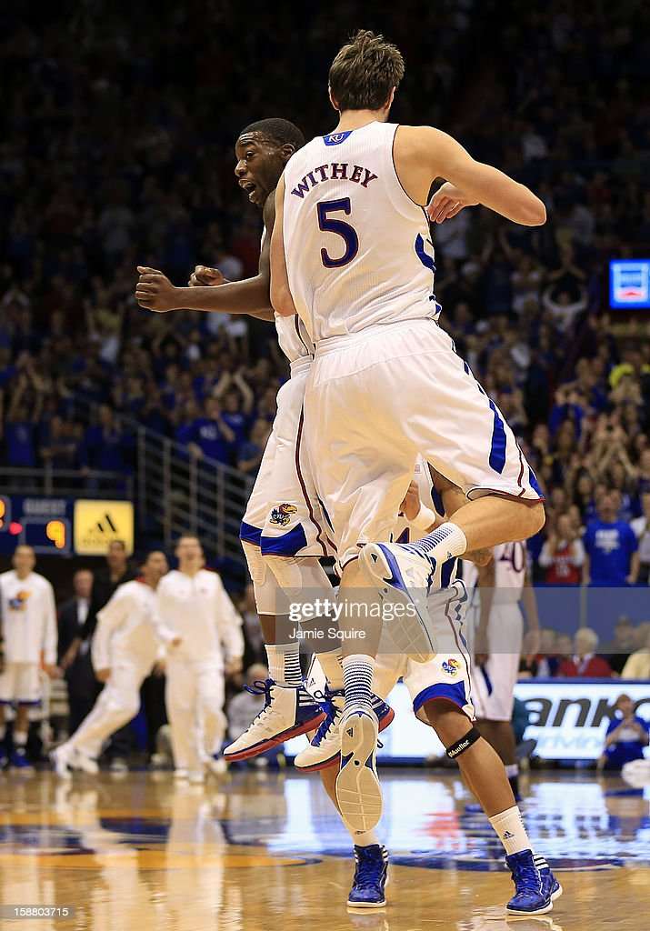 <a gi-track='captionPersonalityLinkClicked' href=/galleries/search?phrase=Jeff+Withey&family=editorial&specificpeople=6669172 ng-click='$event.stopPropagation()'>Jeff Withey</a> #5 of the Kansas Jayhawks is congratulated by Elijah Johnson #15 after scoring during the game against the American University Eagles at Allen Fieldhouse on December 29, 2012 in Lawrence, Kansas.