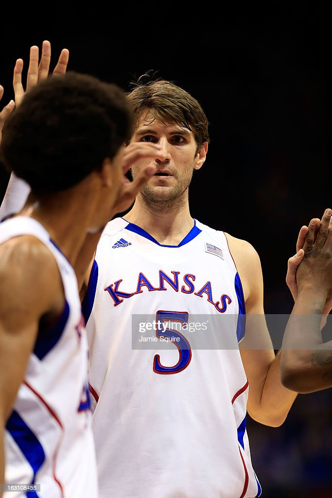 Jeff Withey #5 of the Kansas Jayhawks is congratulated by Kevin Young #40 after scoring during the game against the Texas Tech Red Raiders at Allen Fieldhouse on March 4, 2013 in Lawrence, Kansas.