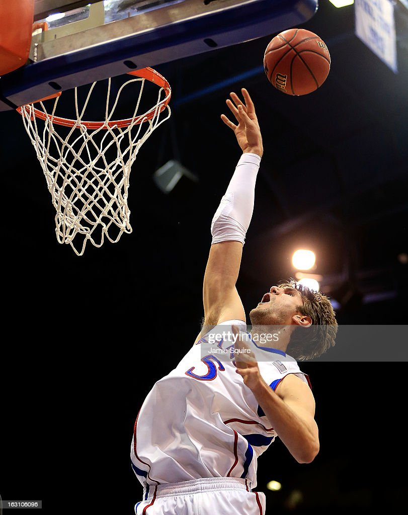 Jeff Withey #5 of the Kansas Jayhawks jumps for a rebound during the game against the Texas Tech Red Raiders at Allen Fieldhouse on March 4, 2013 in Lawrence, Kansas.