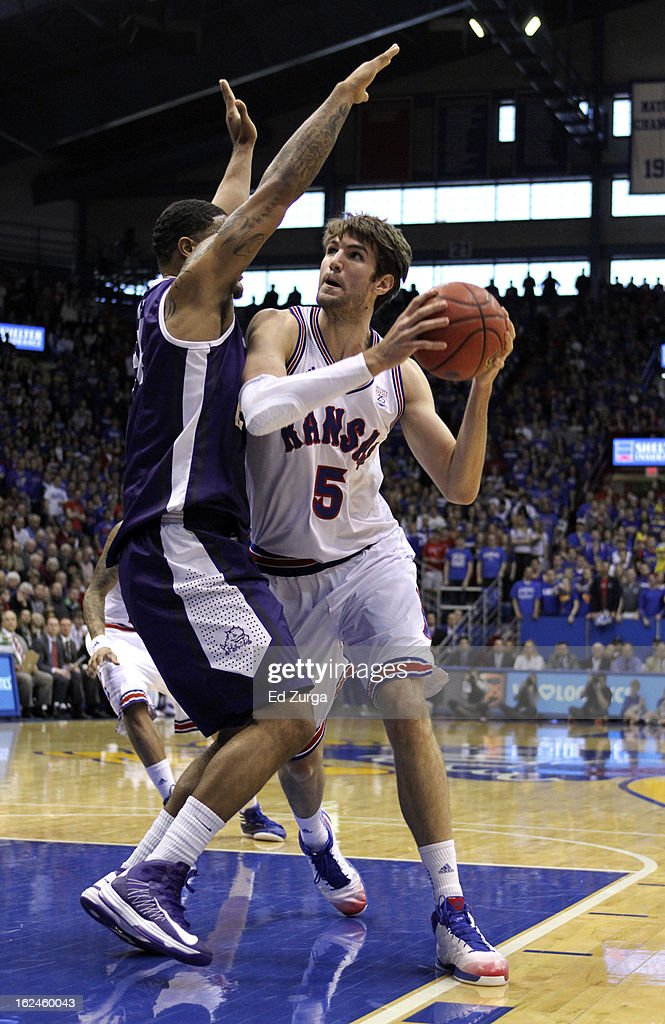 <a gi-track='captionPersonalityLinkClicked' href=/galleries/search?phrase=Jeff+Withey&family=editorial&specificpeople=6669172 ng-click='$event.stopPropagation()'>Jeff Withey</a> #5 of the Kansas Jayhawks looks to drive around Adrick McKinney #24 of the TCU Horned Frogs at Allen Field House on February 23, 2013 in Lawrence, Kansas.