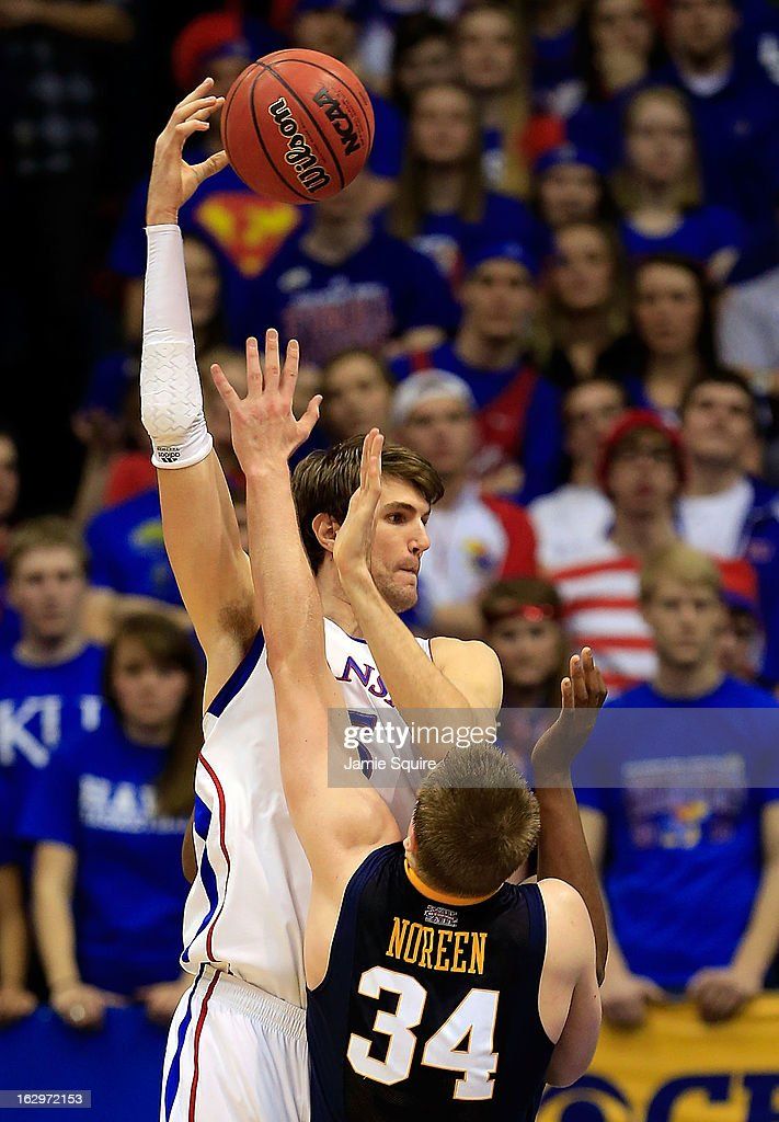<a gi-track='captionPersonalityLinkClicked' href=/galleries/search?phrase=Jeff+Withey&family=editorial&specificpeople=6669172 ng-click='$event.stopPropagation()'>Jeff Withey</a> #5 of the Kansas Jayhawks shoots a sky hook over Kevin Noreen #34 of the West Virginia Mountaineers during the game at Allen Fieldhouse on March 2, 2013 in Lawrence, Kansas.