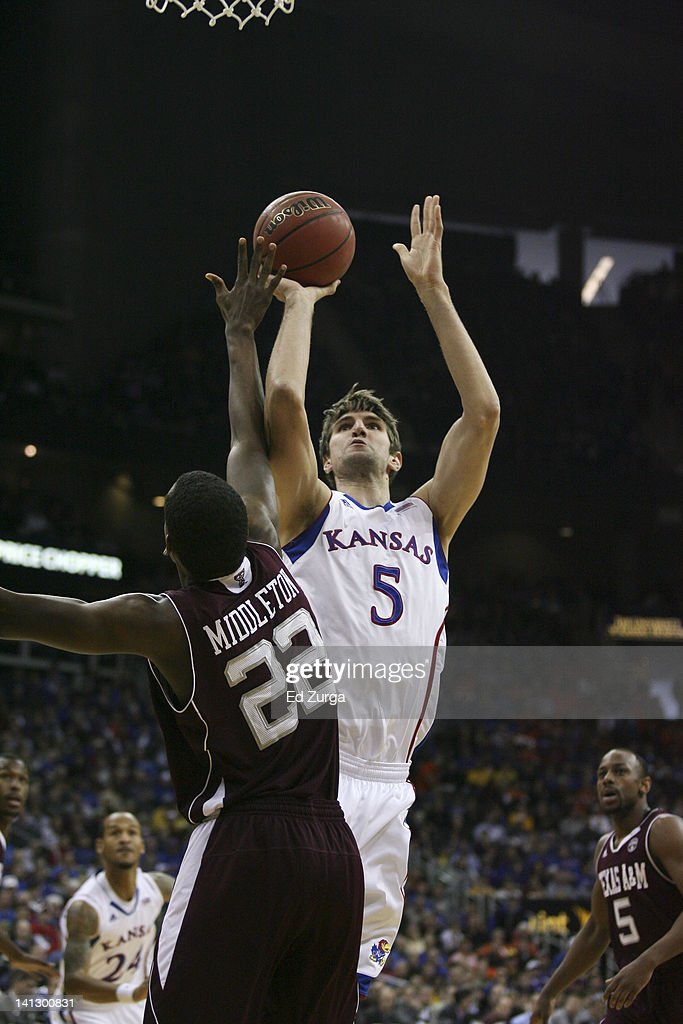 Jeff Withey #5 of the Kansas Jayhawks shoots over Khris Middleton #22 of the Texas A&M Aggies during the quarterfinals of the Big 12 Basketball Tournament March 8, 2012 at Sprint Center in Kansas City, Missouri.