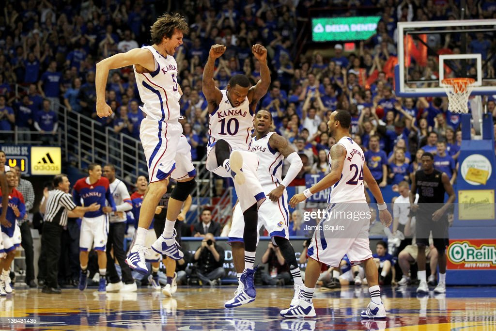 Jeff Withey Tyshawn Taylor Thomas Robinson and Travis Rutherford of the Kansas Jayhawks celebrate after scoring during the game against the Kansas...