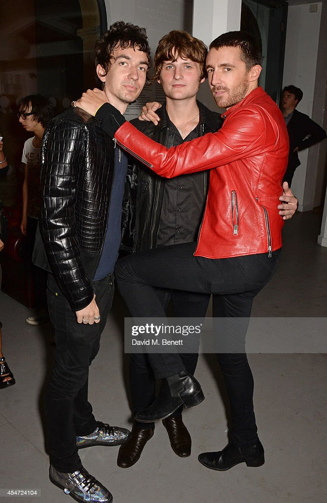 Jeff Wootton, Jay Sharrock and <a gi-track='captionPersonalityLinkClicked' href=/galleries/search?phrase=Miles+Kane&family=editorial&specificpeople=4860678 ng-click='$event.stopPropagation()'>Miles Kane</a> attend the Soho House event to celebrate Kasabian's performance at the iTunes Festival London on September 5, 2014 in London, United Kingdom.
