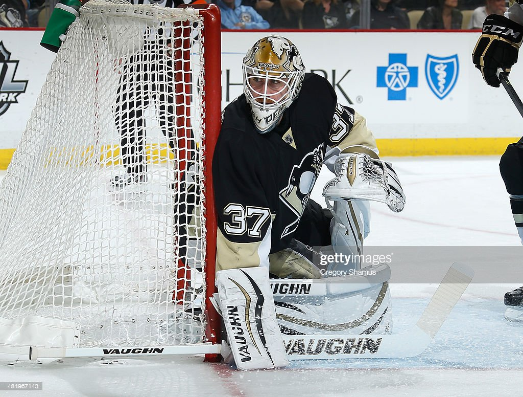 Jeff Zatkoff #37 of the Pittsburgh Penguins defends the net against the Ottawa Senators on April 13, 2014 at Consol Energy Center in Pittsburgh, Pennsylvania.