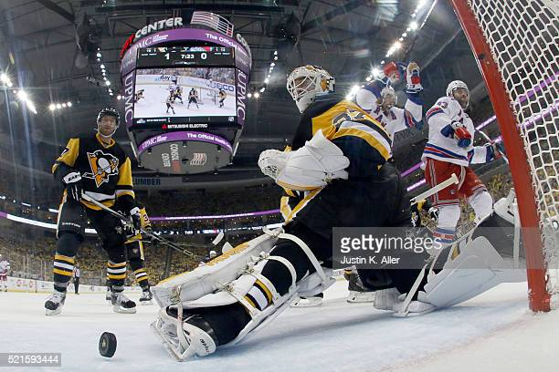 Jeff Zatkoff of the Pittsburgh Penguins looks back after being scored on by Keith Yandle of the New York Rangers in the second period in Game Two of...
