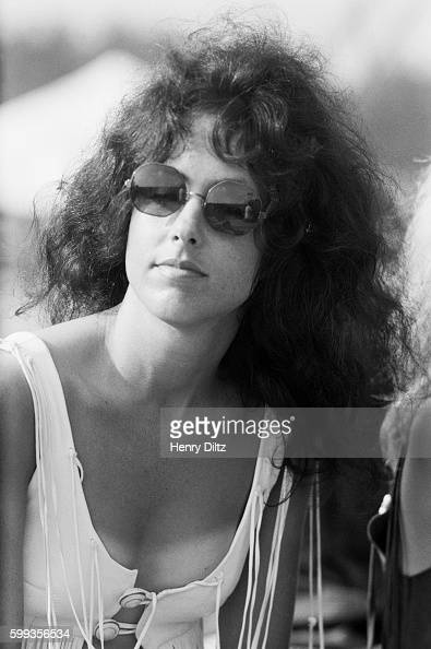 Jefferson Airplane singer Grace Slick sits backstage at the free Woodstock Music and Art Fair The festival took place on Max Yasgur's dairy farm...