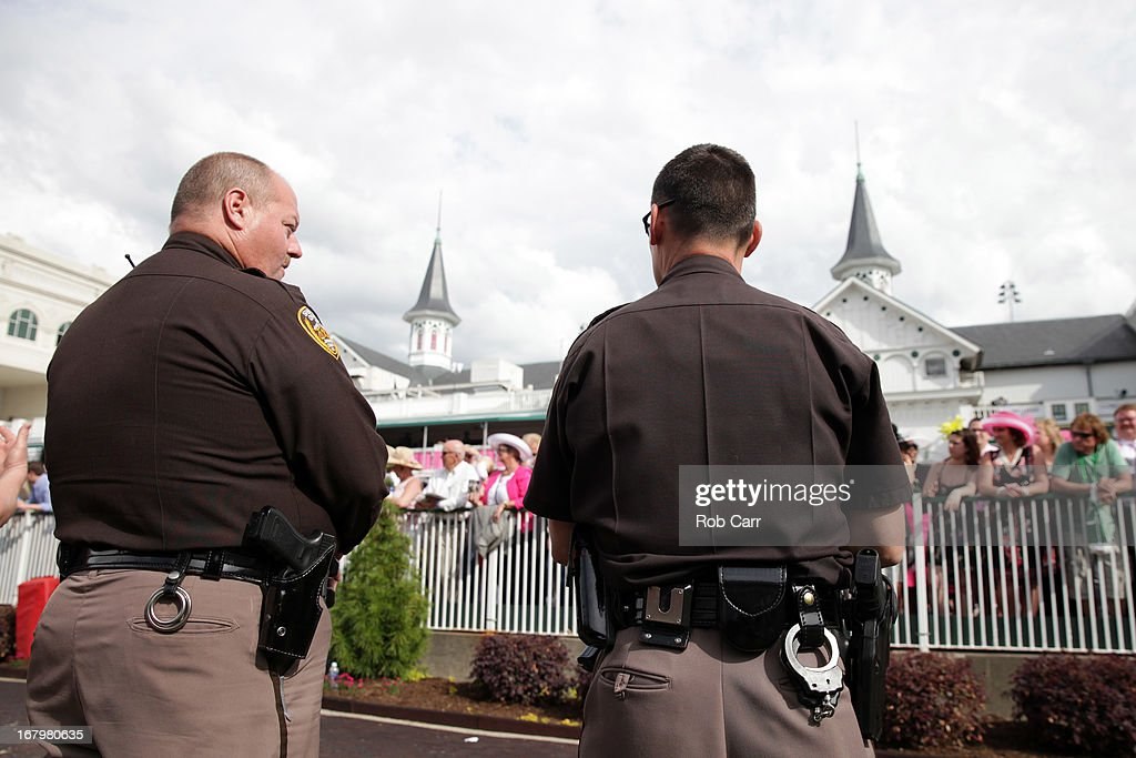 Jefferson County Sheriffs stand in the paddock prior to the 139th running of the Kentucky Oaks at Churchill Downs on May 3, 2013 in Louisville, Kentucky.
