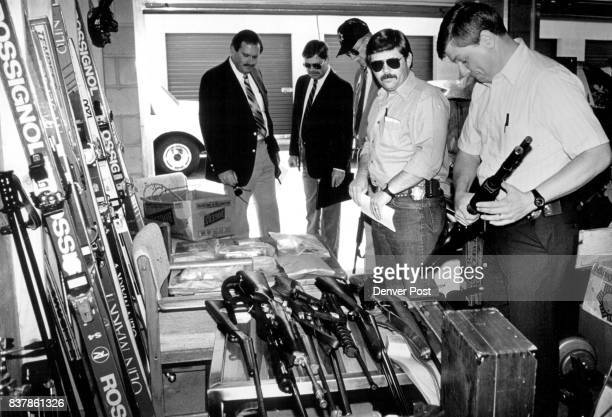 Jefferson County Sherriff's Dept Investigator Philip Hy inspecting one of the weapgns found in a Lakewood storage locker Police located three lockers...