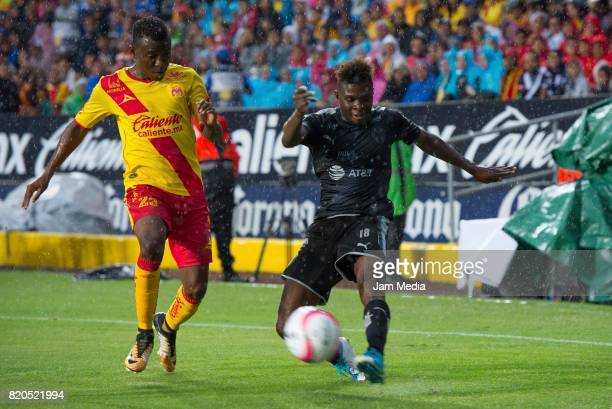 Jefferson Cuero del Morelia and Aviles Hurtado of Monterrey fight for the ball during the 1st round match between Morelia and Monterrey as part of...