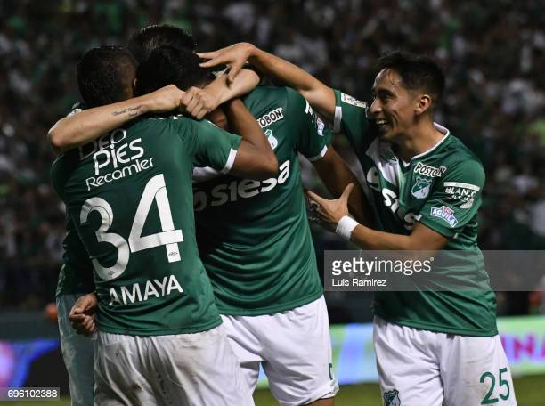 Jefferson Duque of Deporivo Cali celebrates with teammates after scoring the second goal of his team during the Final first leg match between...