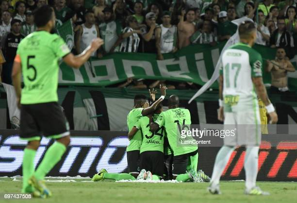 Jefferson Duque of Deportivo Cali celebrates with teammates after scoring the first goal of his team during the Final second leg match between...
