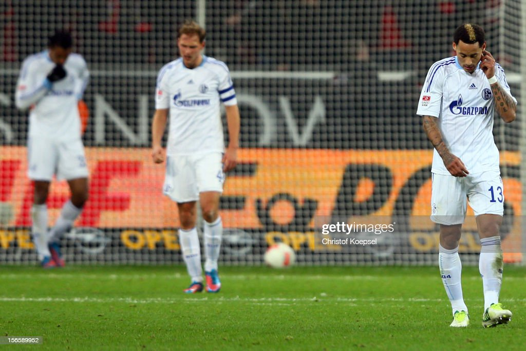 Jefferson Farfan, Benedikt Hoewedes and <a gi-track='captionPersonalityLinkClicked' href=/galleries/search?phrase=Jermaine+Jones+-+Jugador+de+f%C3%BAtbol&family=editorial&specificpeople=12906336 ng-click='$event.stopPropagation()'>Jermaine Jones</a> of Schalke look dejected after the second goal of Leverkusen during the Bundesliga match between Bayer 04 Leverkusen and FC Schalke 04 at BayArena on November 17, 2012 in Leverkusen, Germany.