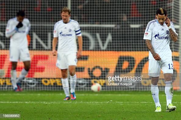 Jefferson Farfan Benedikt Hoewedes and Jermaine Jones of Schalke look dejected after the second goal of Leverkusen during the Bundesliga match...
