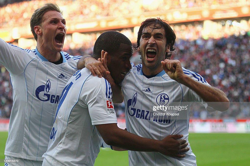Jefferson Farfan celebrates the first goal with Benedikt Hoewedes and Raul Gonzalez of Schalke during the Bundesliga match between Bayer 04...