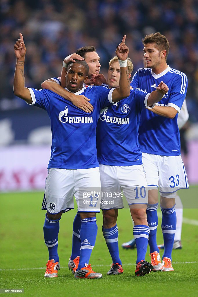 Jefferson Farfan celebrates the first goal with <a gi-track='captionPersonalityLinkClicked' href=/galleries/search?phrase=Marco+Hoeger&family=editorial&specificpeople=6872414 ng-click='$event.stopPropagation()'>Marco Hoeger</a>, <a gi-track='captionPersonalityLinkClicked' href=/galleries/search?phrase=Lewis+Holtby&family=editorial&specificpeople=5351202 ng-click='$event.stopPropagation()'>Lewis Holtby</a> and <a gi-track='captionPersonalityLinkClicked' href=/galleries/search?phrase=Roman+Neustaedter&family=editorial&specificpeople=5437402 ng-click='$event.stopPropagation()'>Roman Neustaedter</a> of Schalke during the Bundesliga match between FC Schalke 04 and FSV Mainz at Veltins-Arena on September 25, 2012 in Gelsenkirchen, Germany.