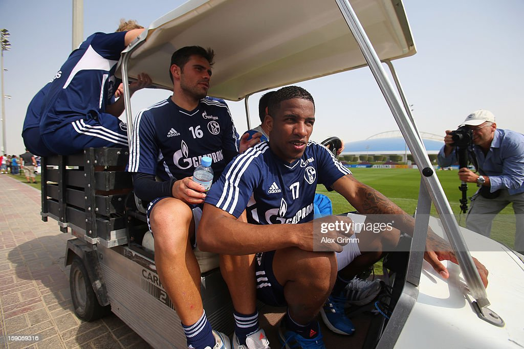 Jefferson Farfan (front), Edu and team mates leave the pitch on a golf cart after a Schalke 04 training session at the ASPIRE Academy for Sports Excellence on January 7, 2013 in Doha, Qatar.