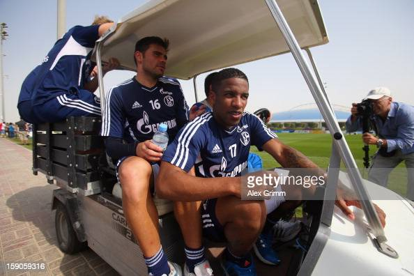 Jefferson Farfan Edu and team mates leave the pitch on a golf cart after a Schalke 04 training session at the ASPIRE Academy for Sports Excellence on...