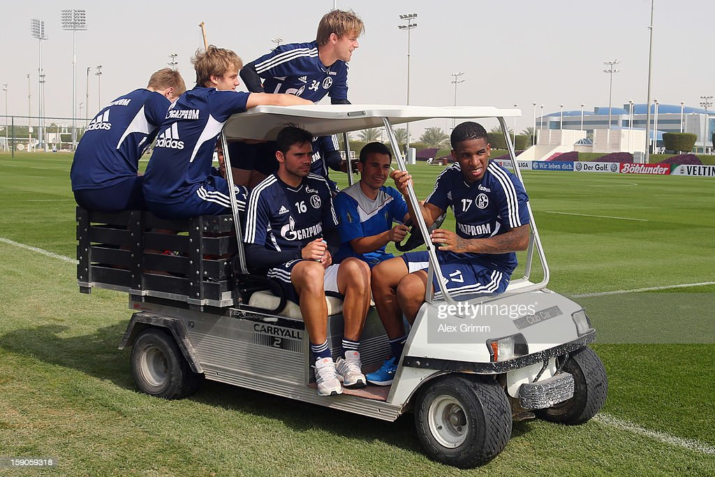 Jefferson Farfan (R), Edu (C) and team mates leave the pitch on a golf cart after a Schalke 04 training session at the ASPIRE Academy for Sports Excellence on January 7, 2013 in Doha, Qatar.