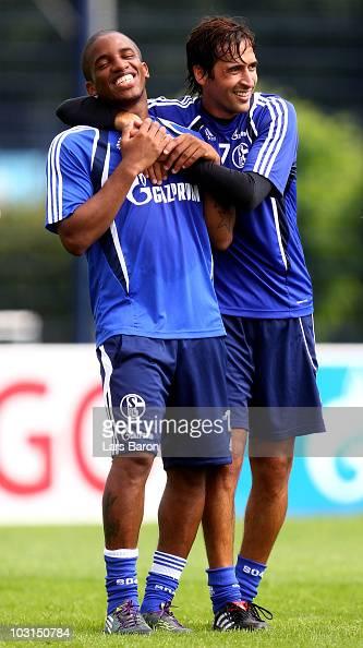 Jefferson Farfan jokes with Raul Gonzalez during a FC Schalke 04 training session at the training ground on July 29 2010 in Gelsenkirchen Germany