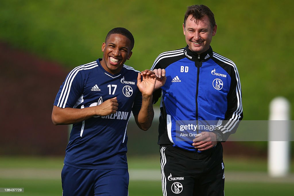 Jefferson Farfan (L) laughs with goalkeeper coach Bernd Dreher during a training session of Schalke 04 at the ASPIRE Academy for Sports Excellence on January 5, 2012 in Doha, Qatar.