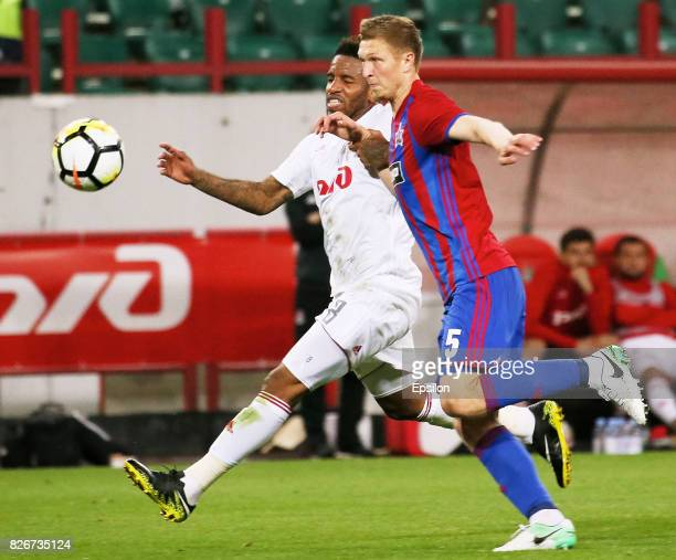 Jefferson Farfan of FC Lokomotiv Moscow vies for the ball with Aleksandr Putsko of FC SKA Khabarovsk during the Russian Premier League match between...