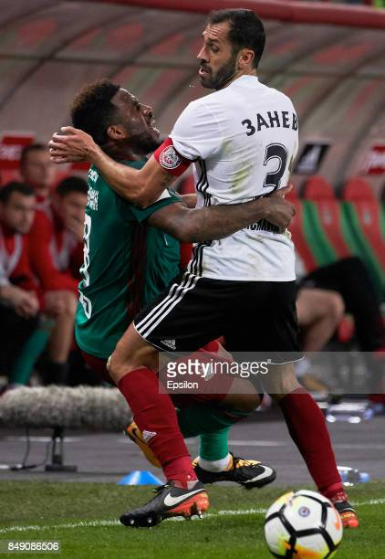Jefferson Farfan of FC Lokomotiv Moscow vies for the ball with Petar Zanev of FC Amkar Perm during the Russian Premier League match between FC...