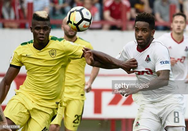 Jefferson Farfan of FC Lokomotiv Moscow vies for the ball with Thomas Phibel of FC Anji Makhachkala during the Russian Premier League match between...