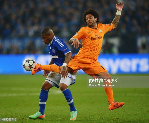 Jefferson Farfan of FC Schalke 04 and Marcelo of Real Madrid battle for the ball during the UEFA Champions League Round of 16 first leg match between...