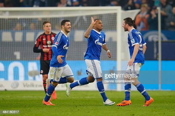 Jefferson Farfan of FC Schalke 04 celebrates with team mates after scoring his team's second goal during the Bundesliga match between FC Schalke 04...