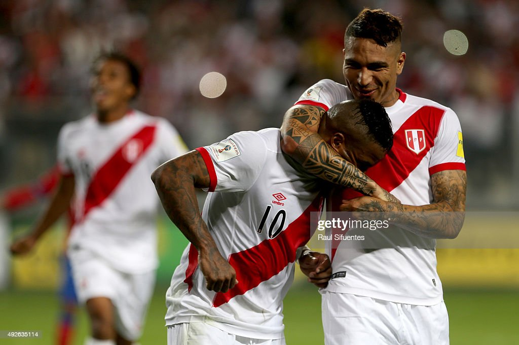 Jefferson Farfan of Peru celebrates with teammate Paolo Guerrero after scoring the second goal of his team against Chile during a match between Peru and Chile as part of FIFA 2018 World Cup Qualifier at Nacional Stadium on October 13, 2015 in Lima, Peru.