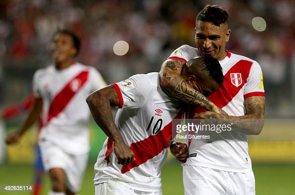 Jefferson Farfan of Peru celebrates with teammate Paolo Guerrero after scoring the second goal of his team against Chile during a match between Peru...