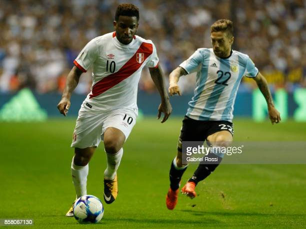 Jefferson Farfan of Peru fights for the ball with Alejandro Gomez of Argentina during a match between Argentina and Peru as part of FIFA 2018 World...