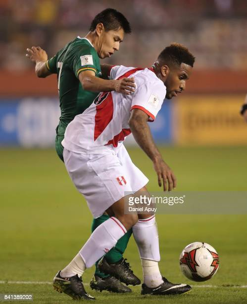 Jefferson Farfan of Peru fights for the ball with Luis Ali of Bolivia during a match between Peru and Bolivia as part of FIFA 2018 World Cup...